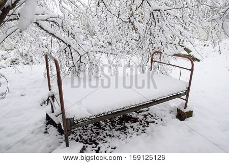 Snow Fell In The Garden. The Old Bed Under A Tree In The Garden. Winter Has Come