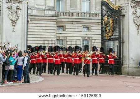 LONDON, ENGLAND - JUNE 17 2016: British Royal guards perform the Changing of the Guard in Buckingham Palace, London, England, Great Britain