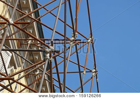 metal scaffolding in building and blue sky background.