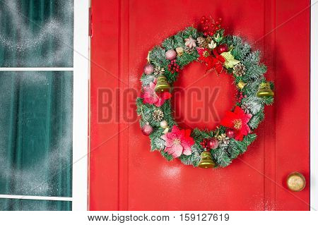 Christmas Wreath With Baubles, Cones And Evergreen Boughs On A Red Door. Texture And Background. Chr