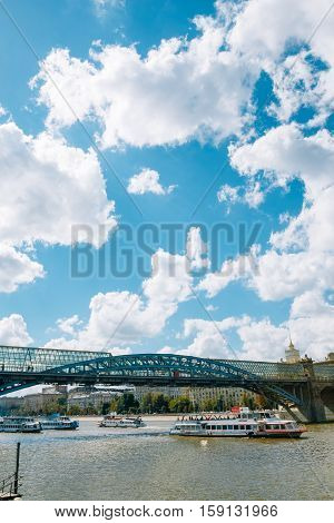 Moscow Russia - August 17 2016: Pushkin foot bridge under which runs river boats