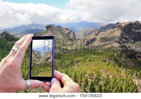 Taking A Photo Of Mountains