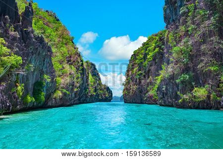 Beautiful tropical blue lagoon. Scenic landscape with sea bay and mountain islands El Nido Palawan Philippines Southeast Asia. Exotic scenery. Popular landmark famous destination of Philippines