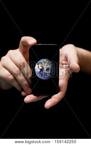 Hands Holding Smartphone showing the planet Earth concept of communications globalization (on black background with very shallow depth of field)