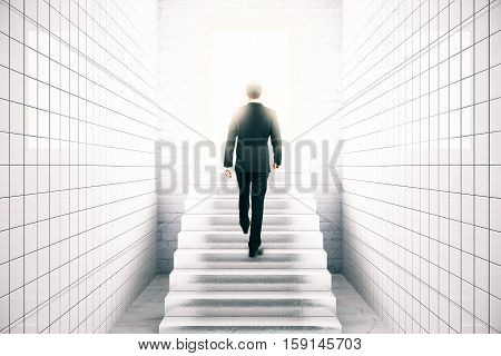 Back view of young businessman in white tile interior climbing stairs. Success concept. 3D Rendering