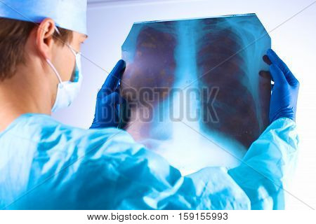 Doctor examining an X-ray of the patient.
