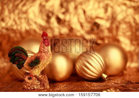 Fire Rooster on a gold background of Christmas toys