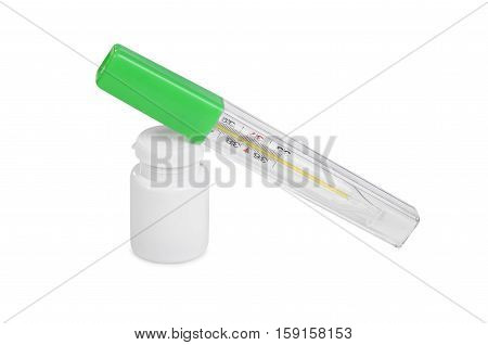 A thermometer and a tube with a medicine on a white background isolation