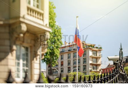 Waving Russian Federation flag waving in front of Consulate of Russia in Strasbourg France. Tilt shift lens used to accent the flag for more natural effect