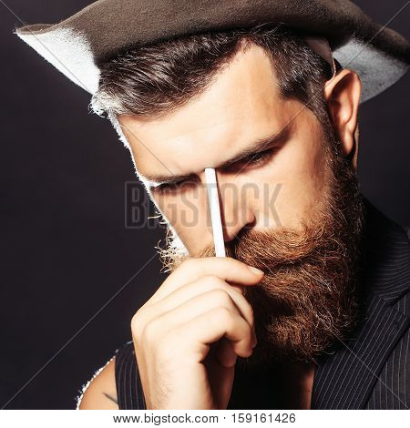 Bearded Man Thinks To Smoke