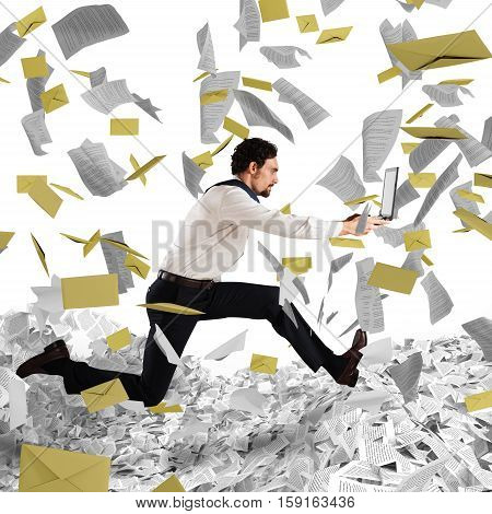 Businessman with laptop runs away from a paperwork and bureaucracy