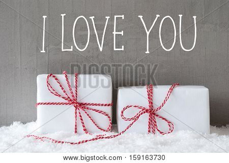 English Text I Love You. Two White Christmas Gifts Or Presents On Snow. Cement Wall As Background. Modern And Urban Style. Card For Birthday Or Seasons Greetings.