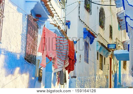 Clothes Hanging On A Street In Medina