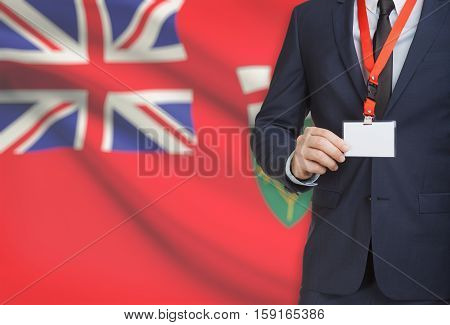 Businessman Holding Badge On A Lanyard With Canadian Province Flag On Background - Ontario