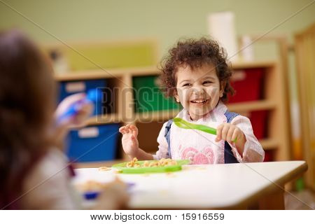 Children Eating Lunch In Kindergarten