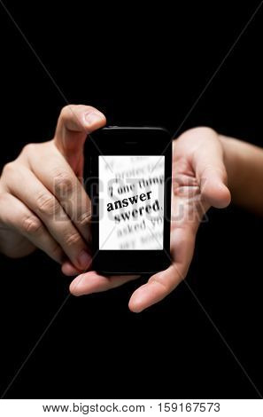 Hands Holding Smartphone, Showing  The Word Answer  Printed