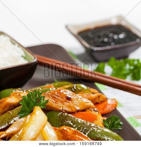 Chicken and Rice with Vegetable Spicy Sesame Teriyaki Wok Sauce. Selective focus.