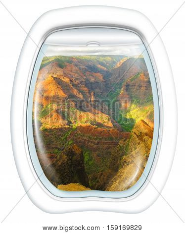 Plane window on colorful Waimea Canyon State Park, also called Grand Canyon of Pacific, at sunset in Kauai, Hawaii, United States, from a plane through the porthole. Copy space.