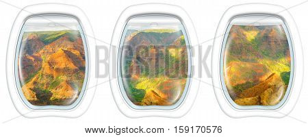 Three plane windows on colorful Waimea Canyon State Park, also called Grand Canyon of Pacific, at sunset in Kauai, Hawaii, United States, from a plane on the porthole windows. Copy space.