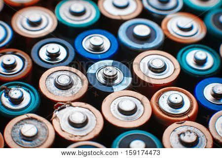 Close up top view on rows of selection of AA batteries energy abstract background of colorful batteries alkaline battery aa size. Several batteries are next to each other. Many aa batteries.