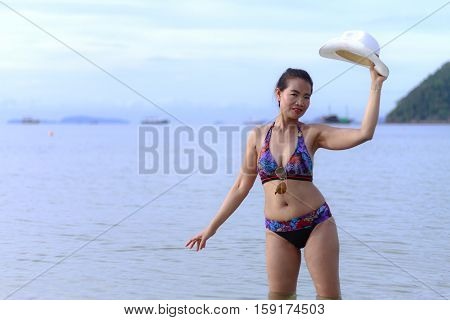 Bikini with women shape sexy hat and sunglasses on Thung Wua Lan Beach at Chumphon Province Thailand
