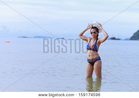 Bikini with women body pretty hat and sunglasses on Thung Wua Lan Beach at Chumphon Province Thailand
