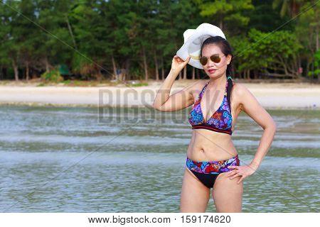 Bikini with women sexy symbol hat and sunglasses on Thung Wua Lan Beach at Chumphon Province Thailand.