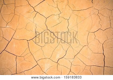 Brown clay earthen wall texture or background