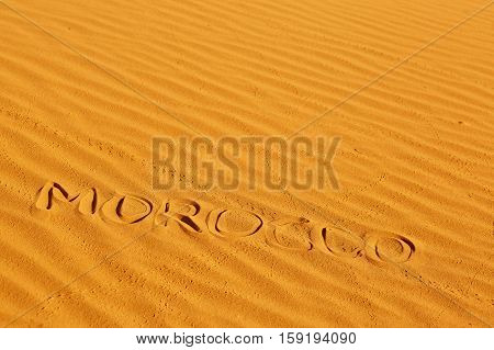 Word Morocco Written On The Sand