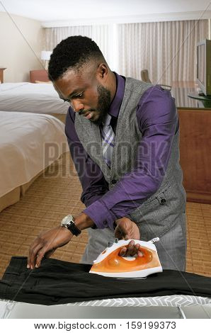 Black Man With Clothes Iron