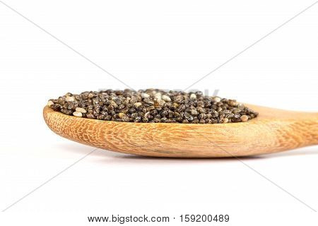 Close up chia seeds in wooden spoon on white background