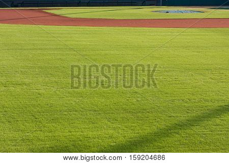 Generic scene of infield dirt and outfield grass of baseball field