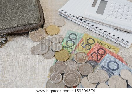 Australian money AUD with calculator notebook and small money pouch