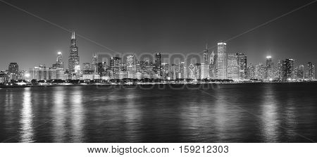 Black And White Night Panoramic Picture Of Chicago City Skyline.