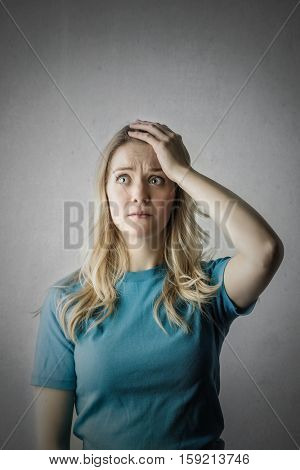 Blonde girl worrying about something