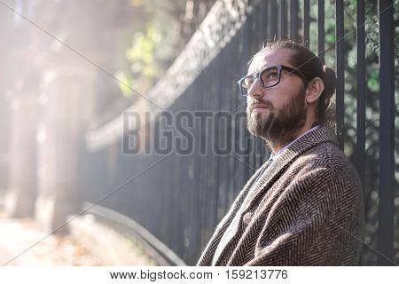 Guy outside in a coat