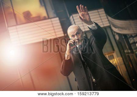 Businessman getting a taxi
