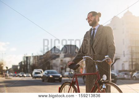 Guy using his bike in a coat