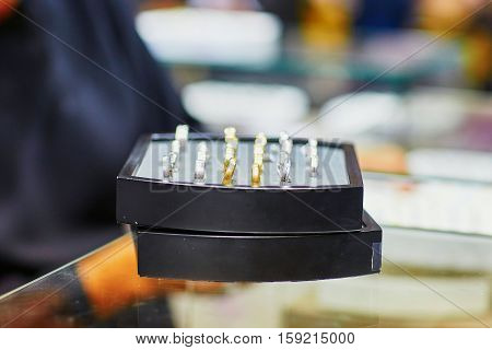 Jeweller Stand With Selection Of Wedding Rings