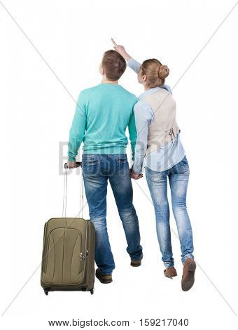Back view of pointing couple with  green suitcase looking up. Rear view people collection.  backside view of person.  Isolated over white background.