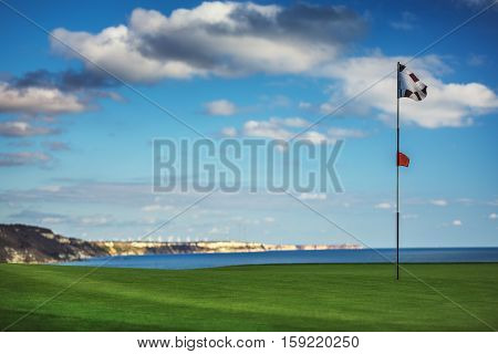 Golf course in the countryside and near sea