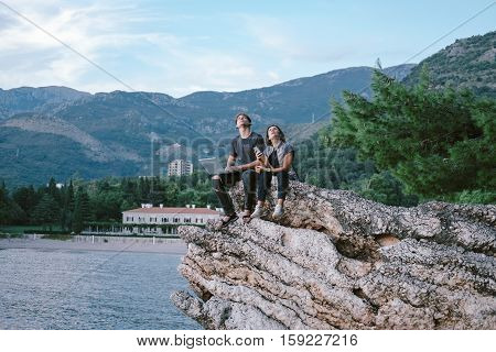 Young Man And Women Freelancers With A Laptop And Phone In  Mountain In Montenegro, Freedom And Trav
