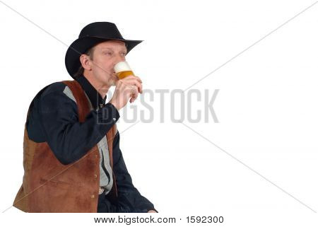 Attractive Cowboy Having A Beer