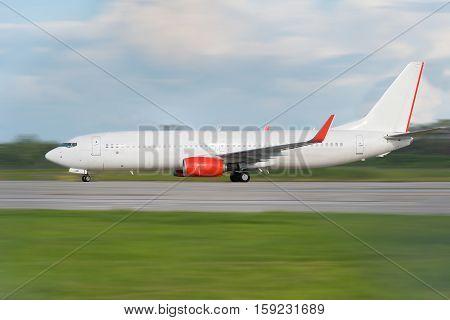 White Passenger Plane Is Landing Away From Airport/white Passenger Plane Is Take Off Away From Airpo