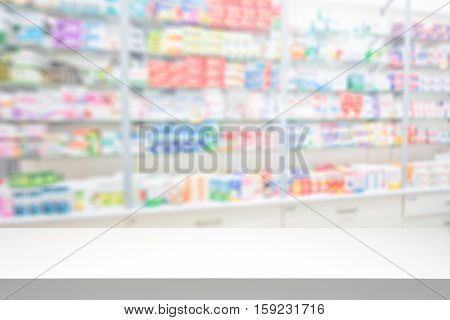 counter store table pharmacy background shelf blurred blur focus drug medical shop drugstore medication blank medicine pharmaceutics concept - stock image