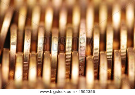 Close Up Of Gold Coins In Rows