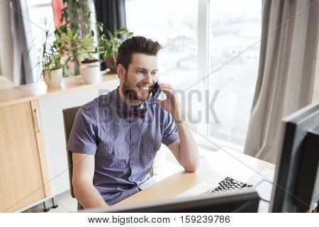 business, startup and people concept - happy businessman or creative male office worker with computer calling on smarphone