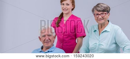 Senior People With Young Nurse