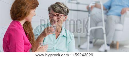 Woman Taking The Medicine