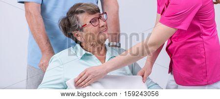 Nurse Covering Senior By Blanket